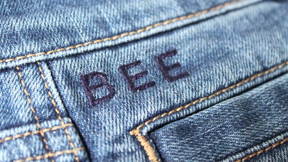 Bee monogrammed jeans hawthorne heaney