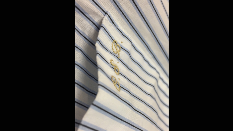 Hand embroidered monogram onto shirt