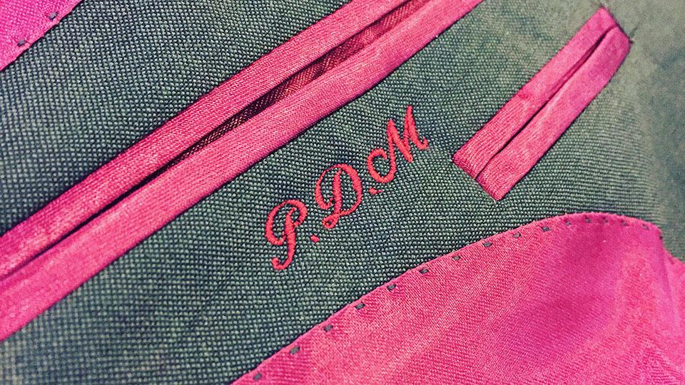 Machine embroidered monogram into jacket