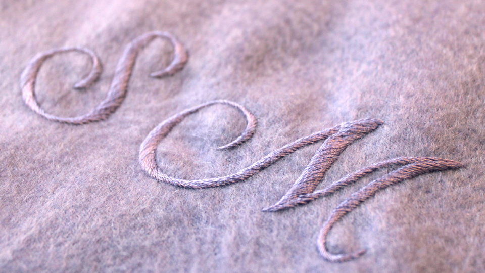 Silk monogram onto cashmere blanket