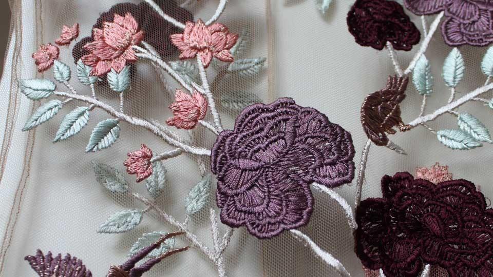 Silk work embroidery onto power mesh for Reem Juan