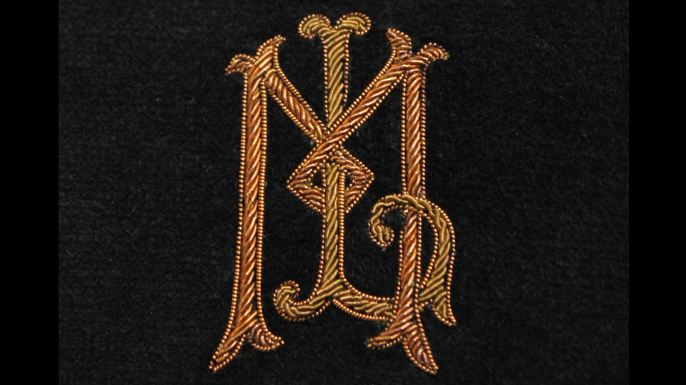 Antique gold embroidered monogram