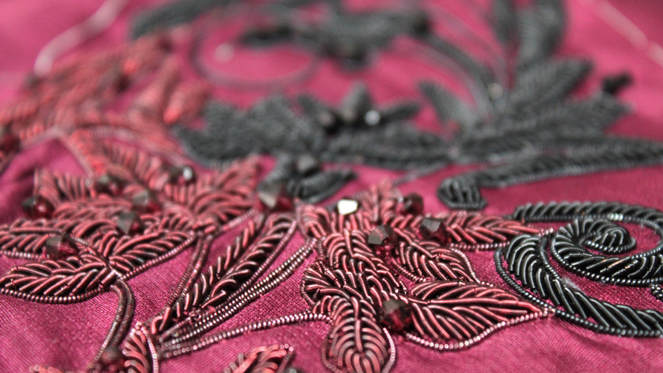 Red bullion embroidery for Hasan Hejazi