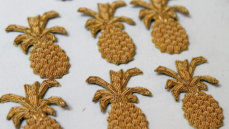 tiny embroidered pineapples goldwork