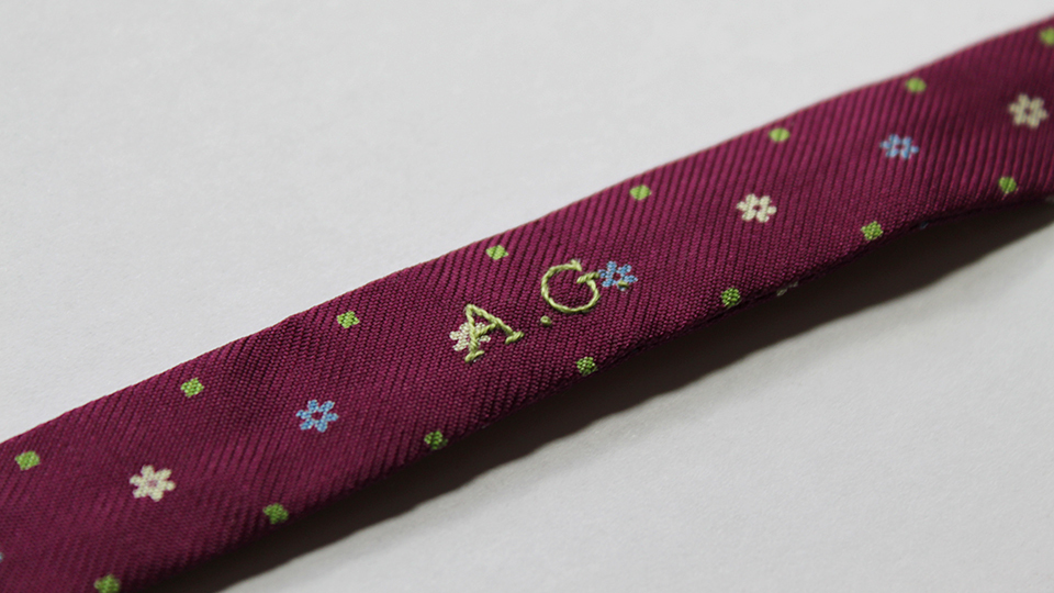 Bow tie monogram embroidery