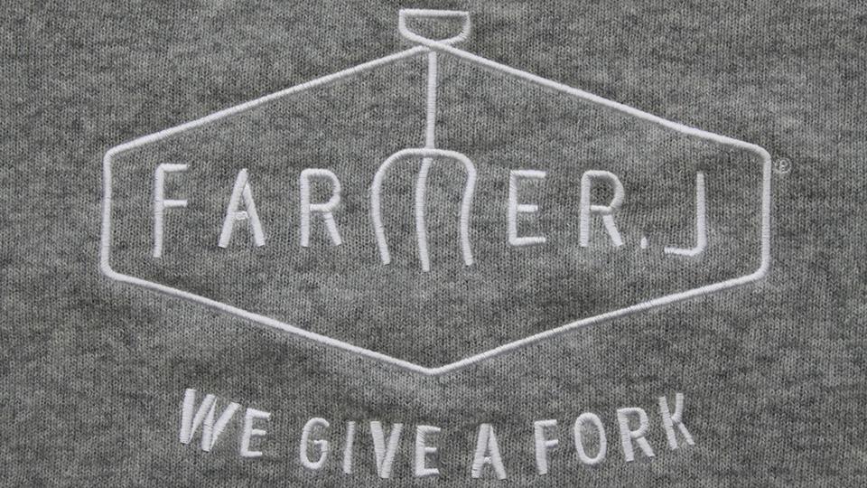 Machine embroidery logo onto knit