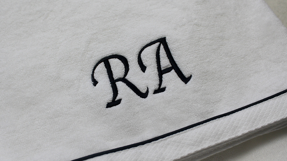 RA machine monogram onto towels
