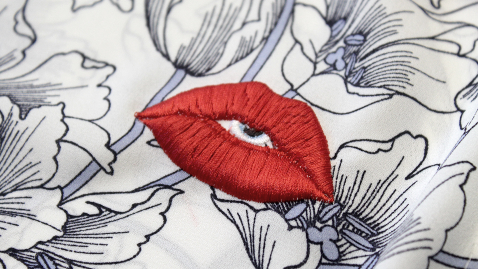 machine embroidered lips logo