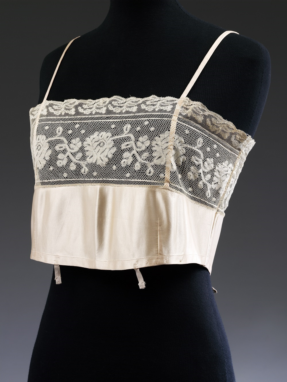 T.368-1976 Brassiere Brassiere, satin, ca. 1929, English England Ca. 1929 Satin and machine made ecru